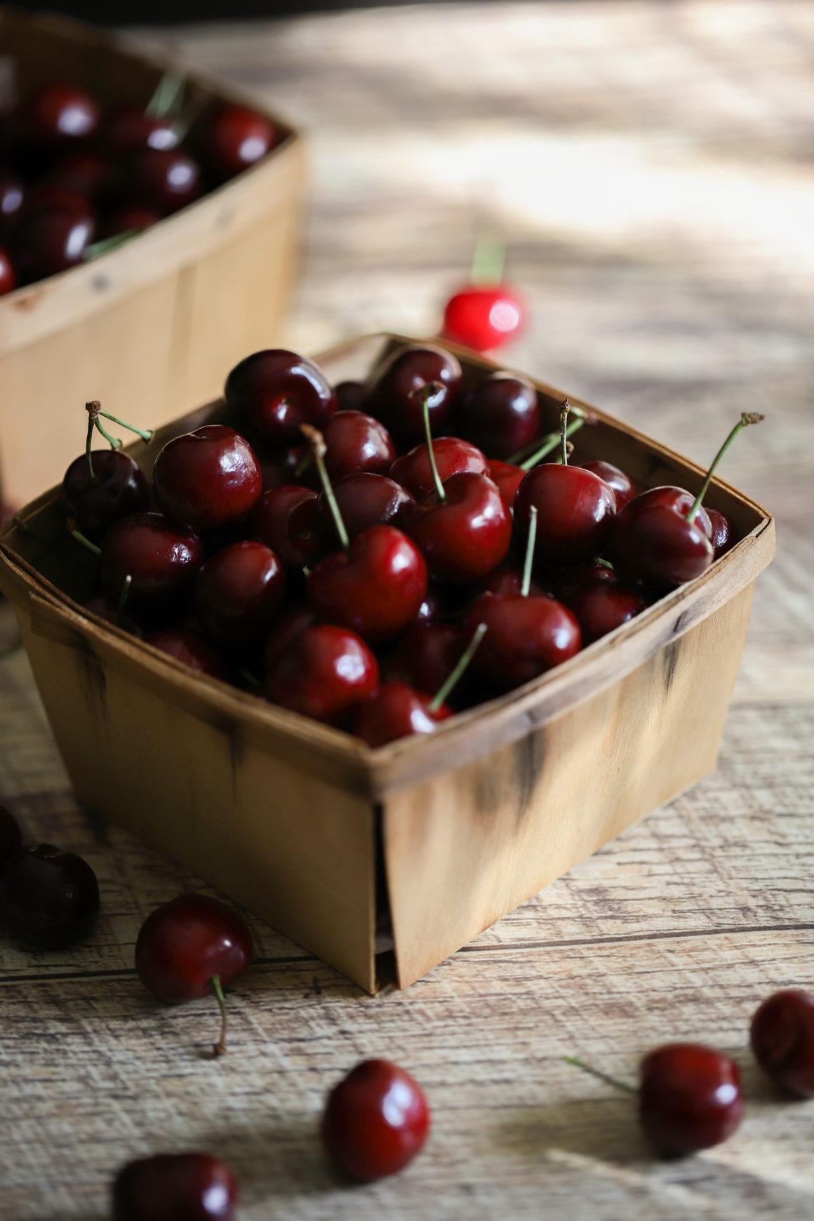 bing cherries in a wooden basket