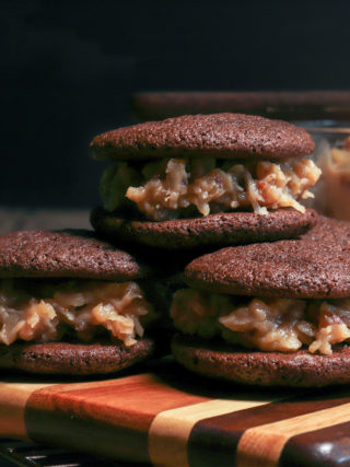 Chocolate Cookie Sandwiches with Coconut Pecan Frosting