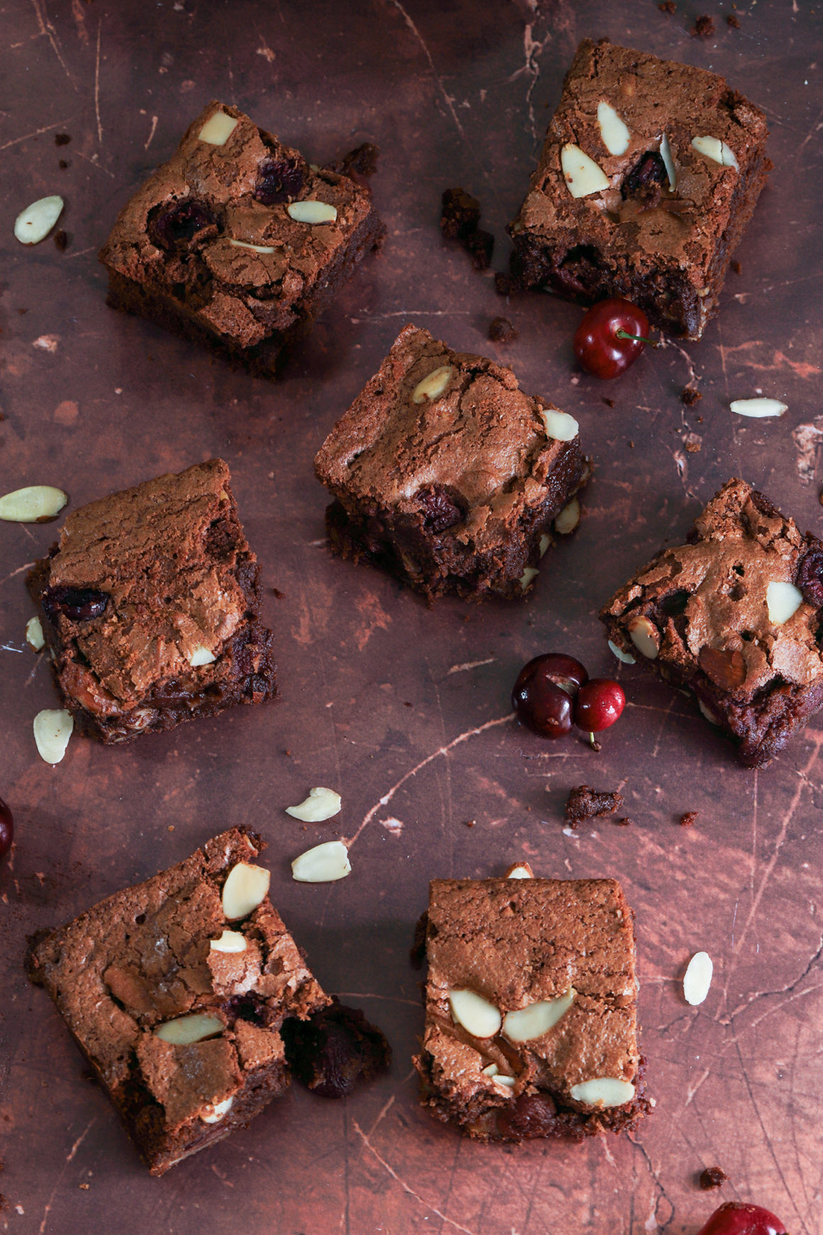 fresh cherry brownies on metal counter
