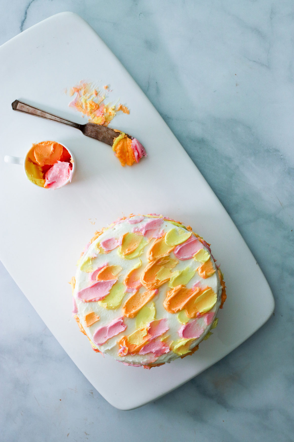 whole carrot cake frosted in easter colors