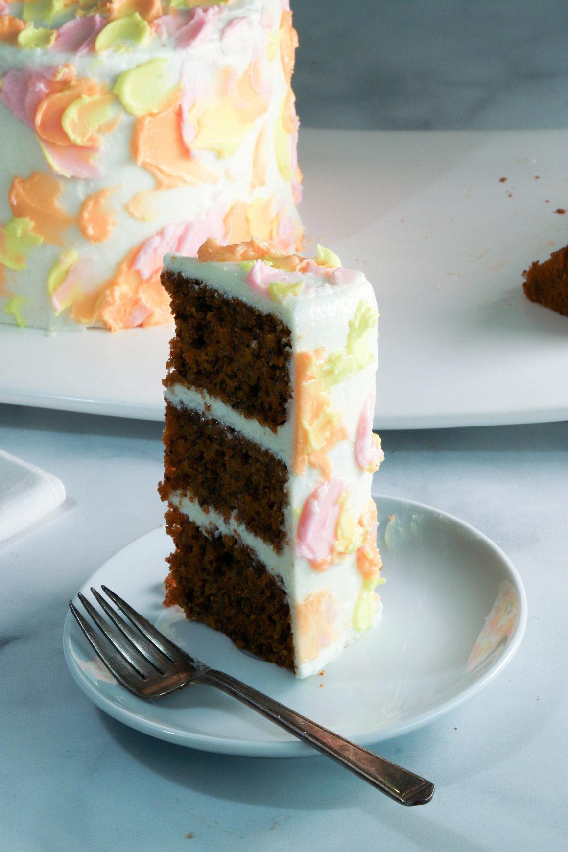 carrot cake slice standing on plate
