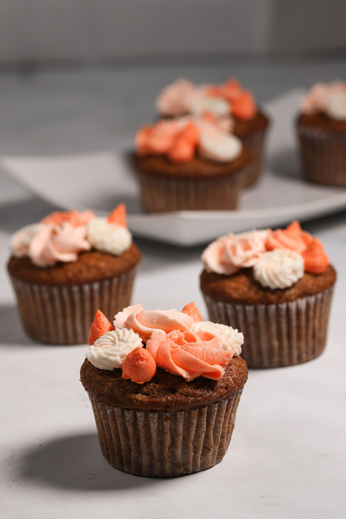 Orange Frosted Pear Cupcakes