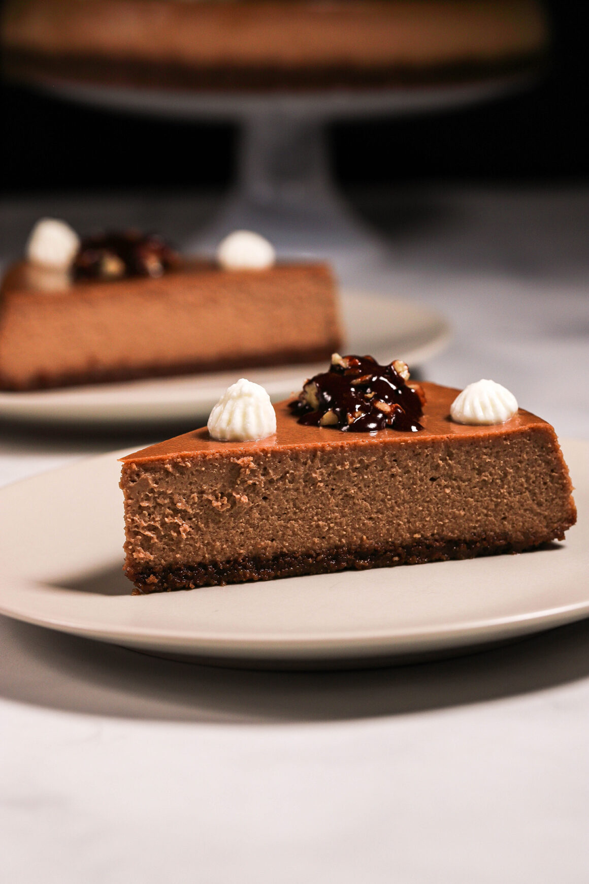 Mocha Cheesecake with Pecans and Espresso Chocolate Sauce