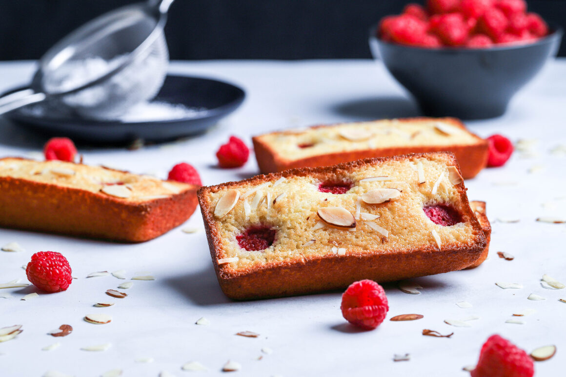 raspberry almond financiers ready for powdered sugar