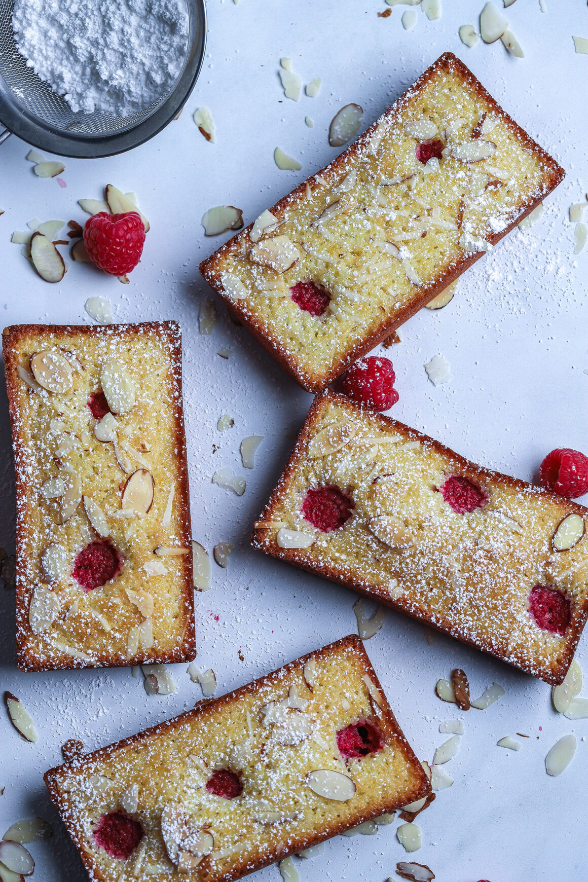raspberry almond financiers dusted with powdered sugar-