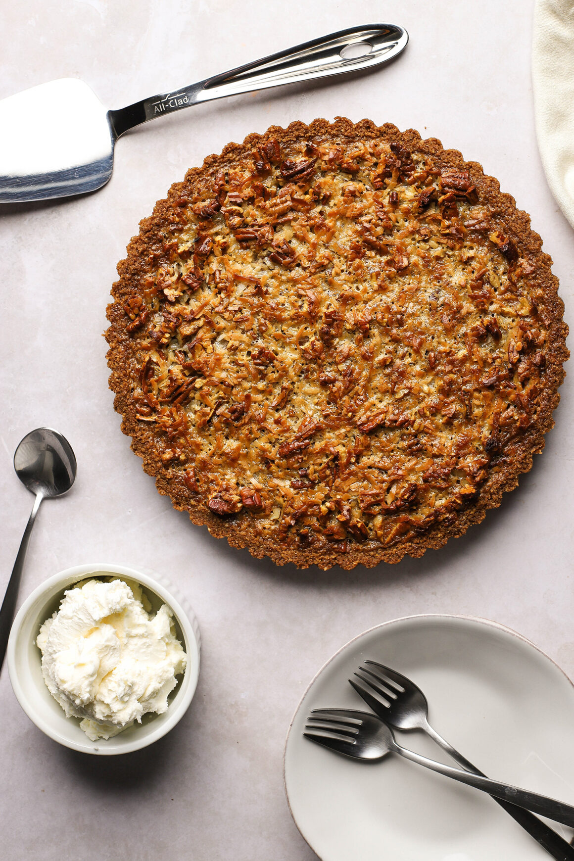 pecan tart with whipped cream