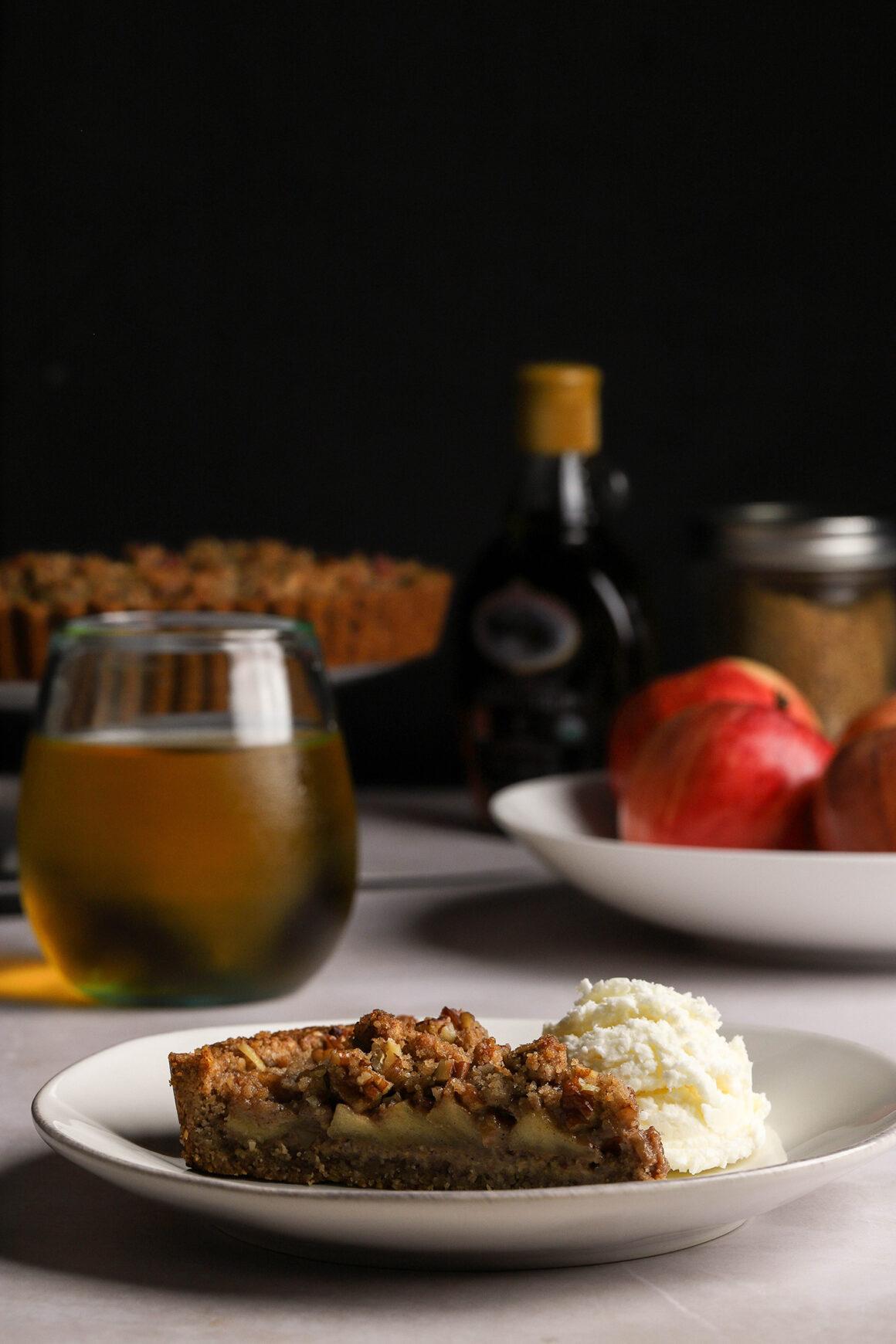 caramel apple pecan tart with whipped cream