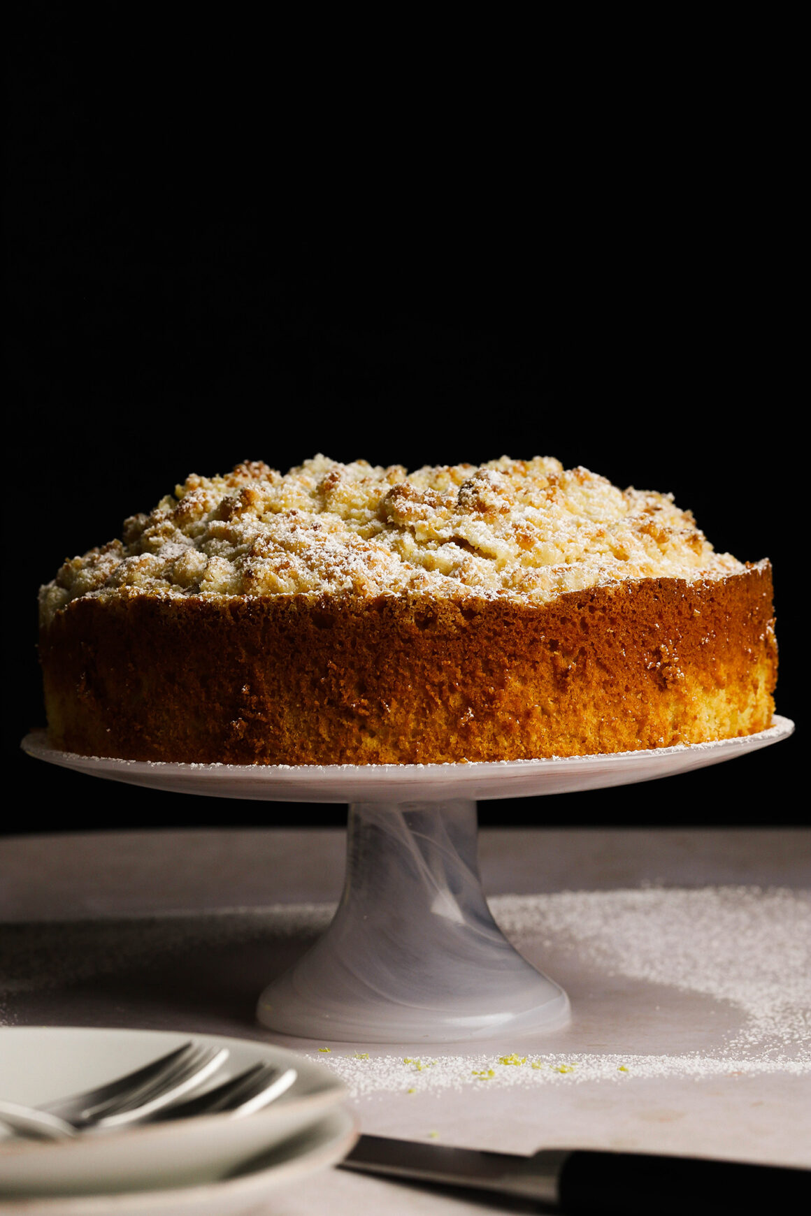 lemon crumble cake on cake stand