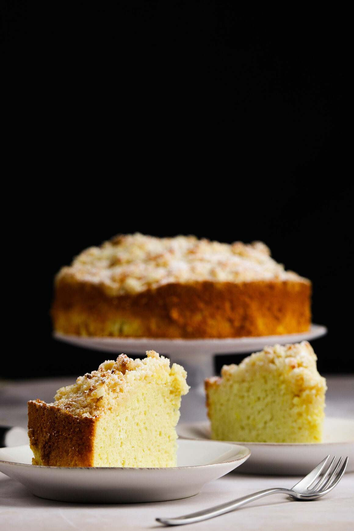 plated slices of lemon cream crumble cake