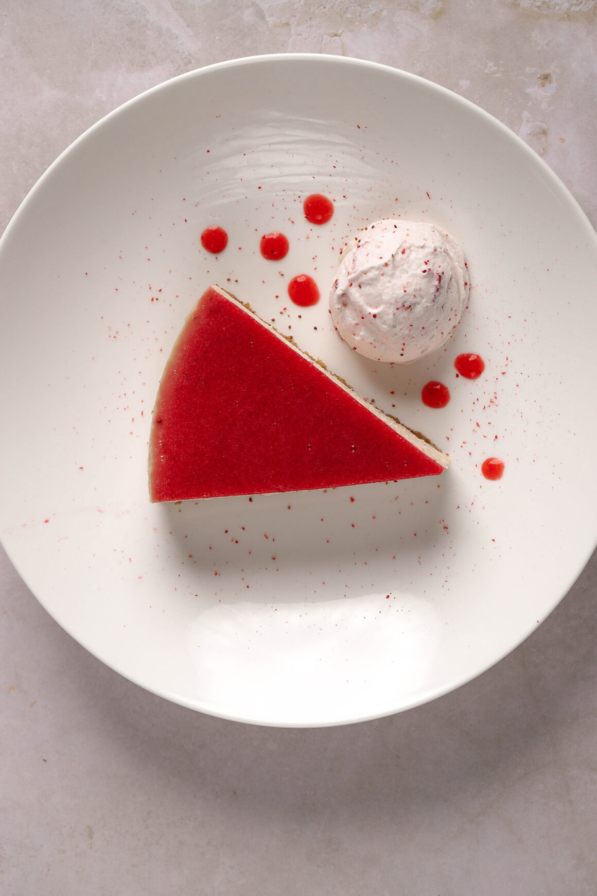 strawberry cheesecake with strawberry sauce and strawberry whipped cream