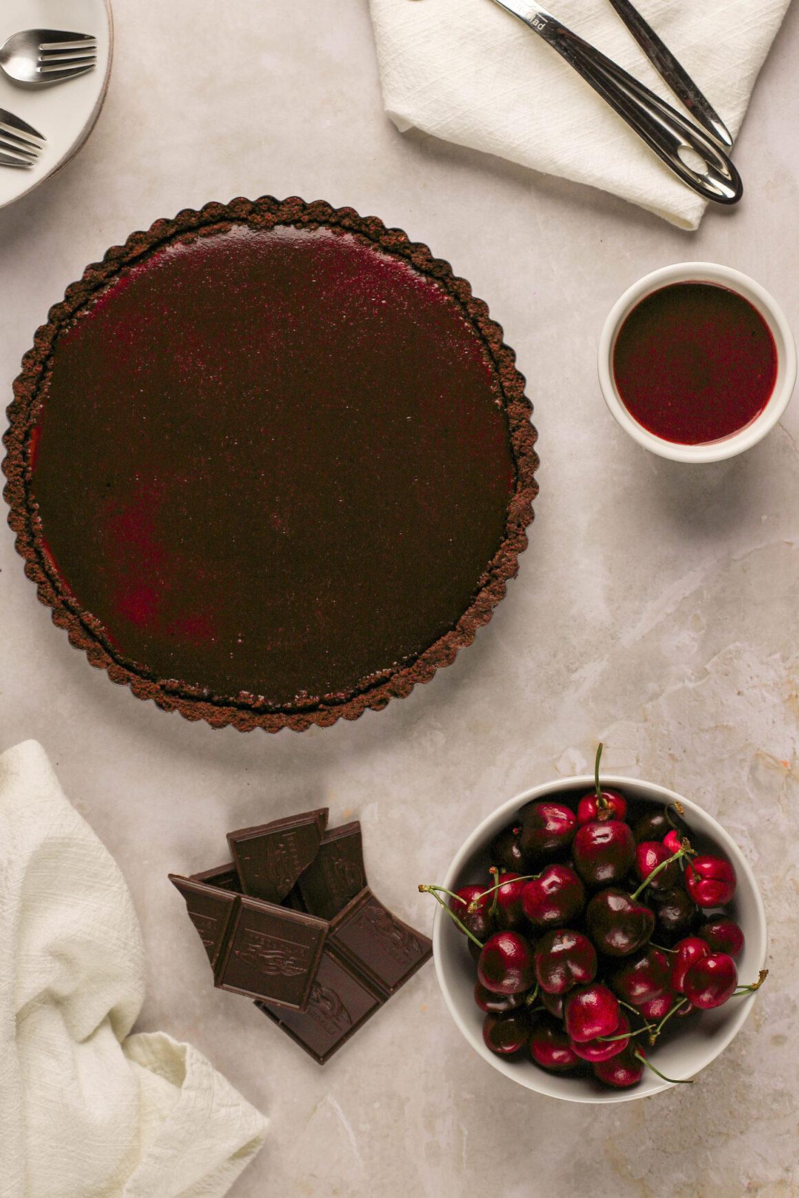 whole cherry chocolate tart with cherry glaze