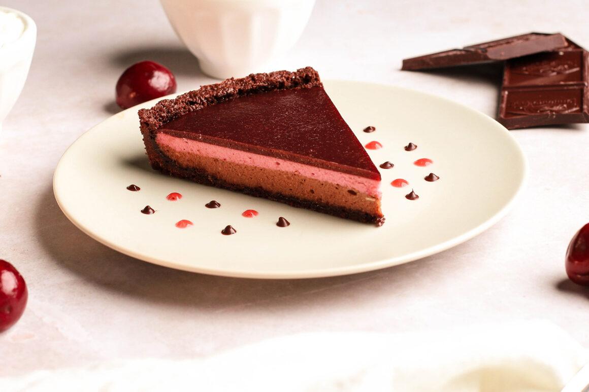 fresh cherry chocolate cheesecake tart slice