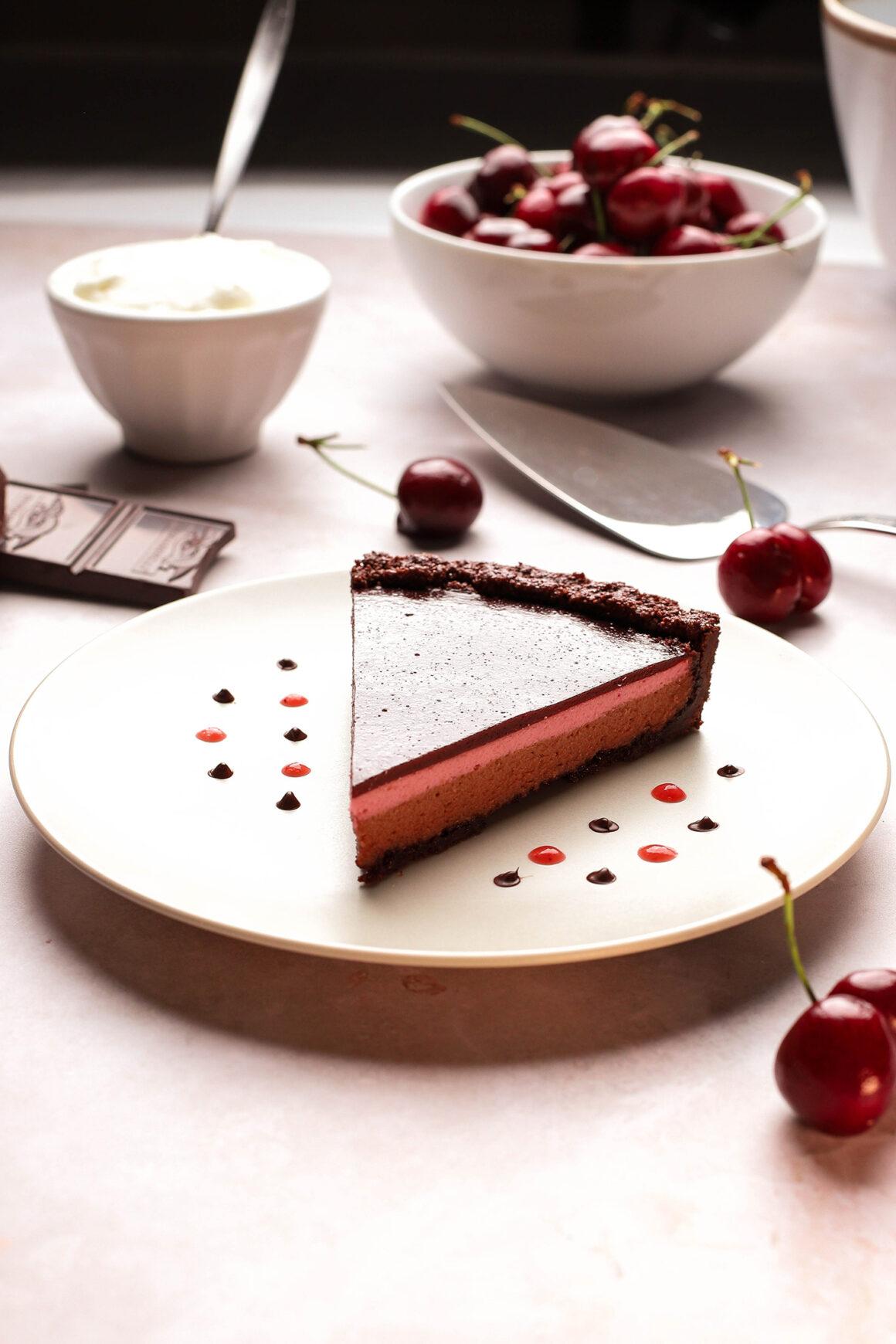 plated chocolate cherry cheesecake tart