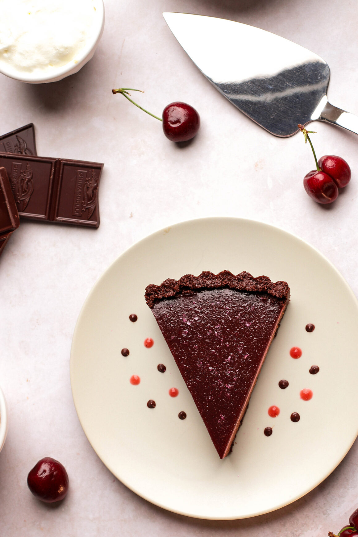 plated cherry chocolate cheesecake tart