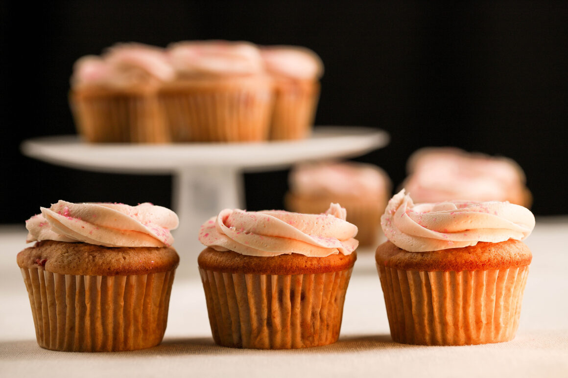 strawberry cupcakes frosted with buttercream
