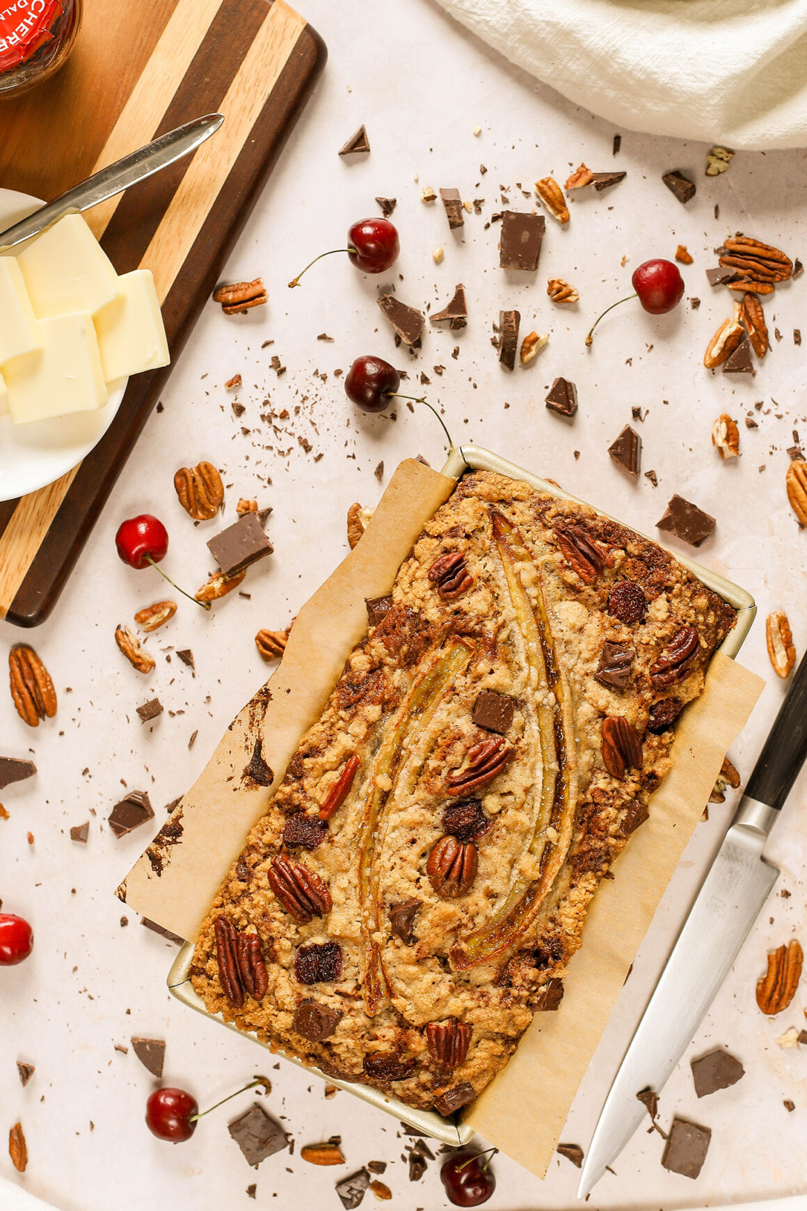 banana bread loaf with cherries, chocolate and pecans
