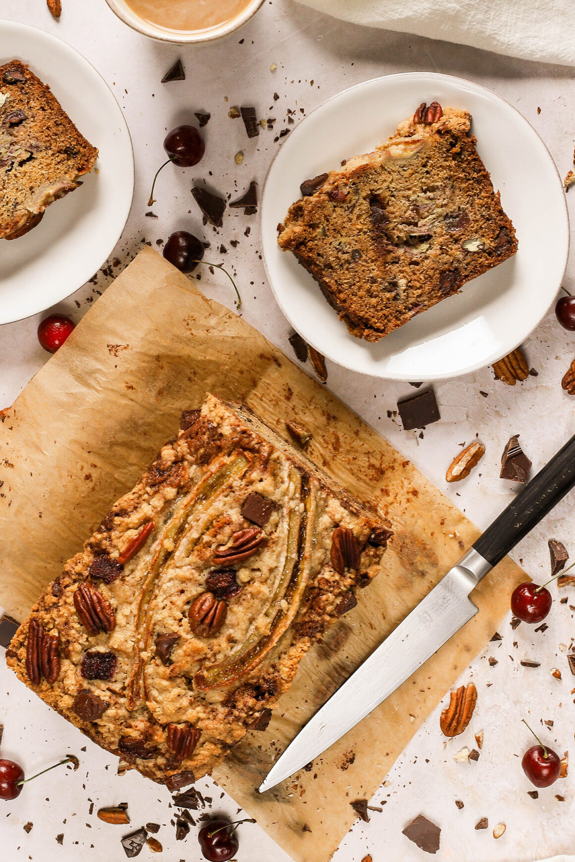 banana bread loaf with chocolate, cherries and pecans