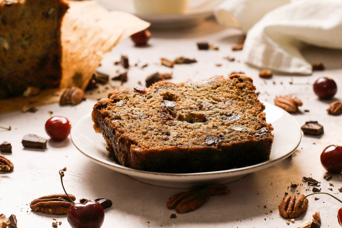 plated banana bread with cherries